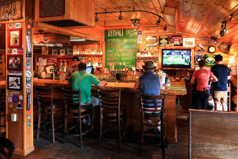 Enjoying the Alaska Brew Pub and Restaurant Talkeetna stock image