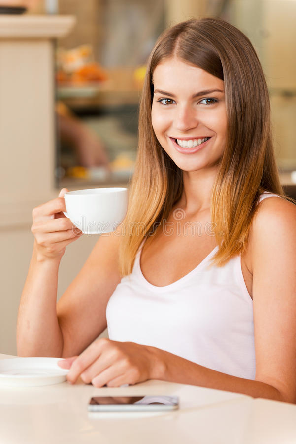 Enjoying the best coffee in town. royalty free stock photo