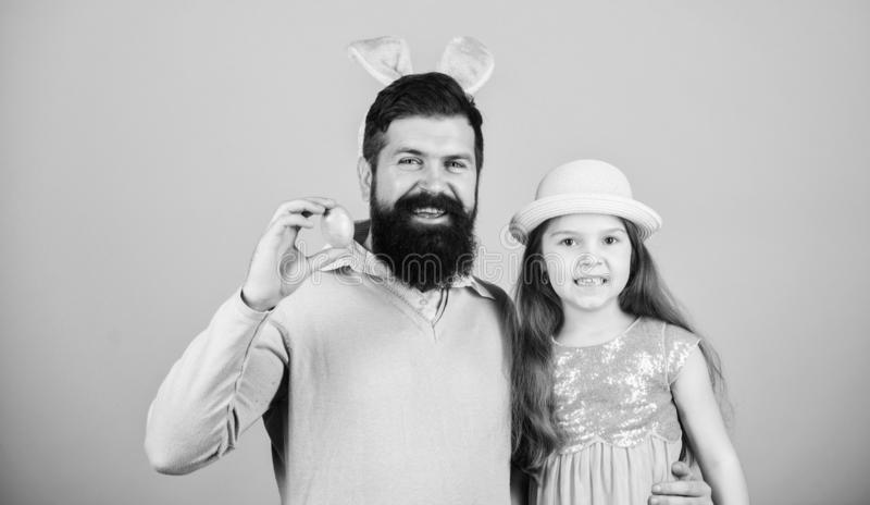 Enjoying the big day. Happy father and child with colored Easter eggs. Family of father bunny and daughter smiling on. Easter. Happy family. Family celebrating royalty free stock images