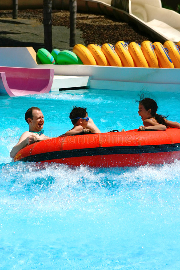 Enjoying the big float slide. stock images