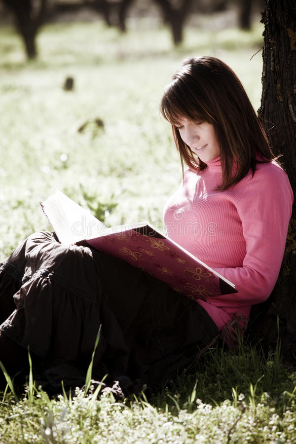 Enjoying a book in the forest royalty free stock photos