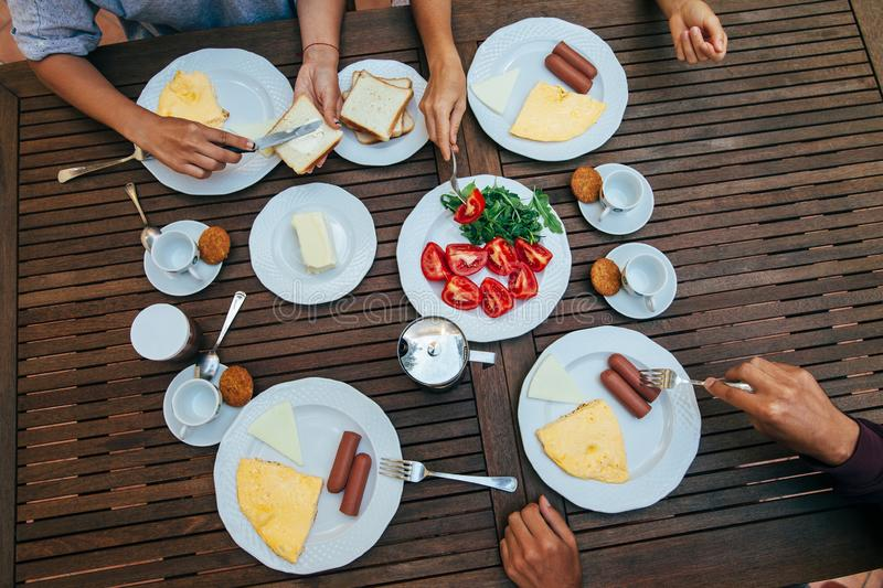 Top view of group of people having breakfast together royalty free stock photo