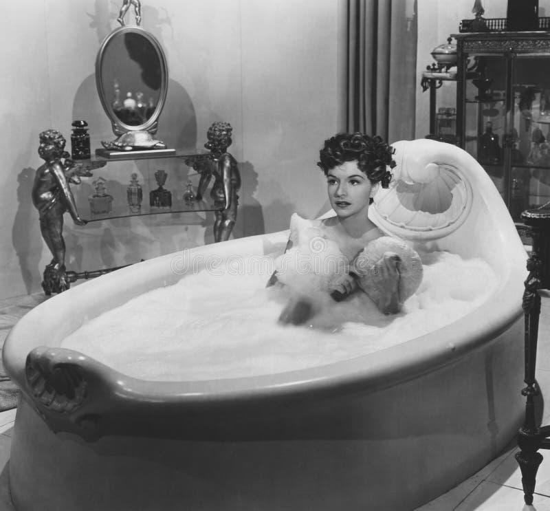 Enjoying a bubble bath stock photos