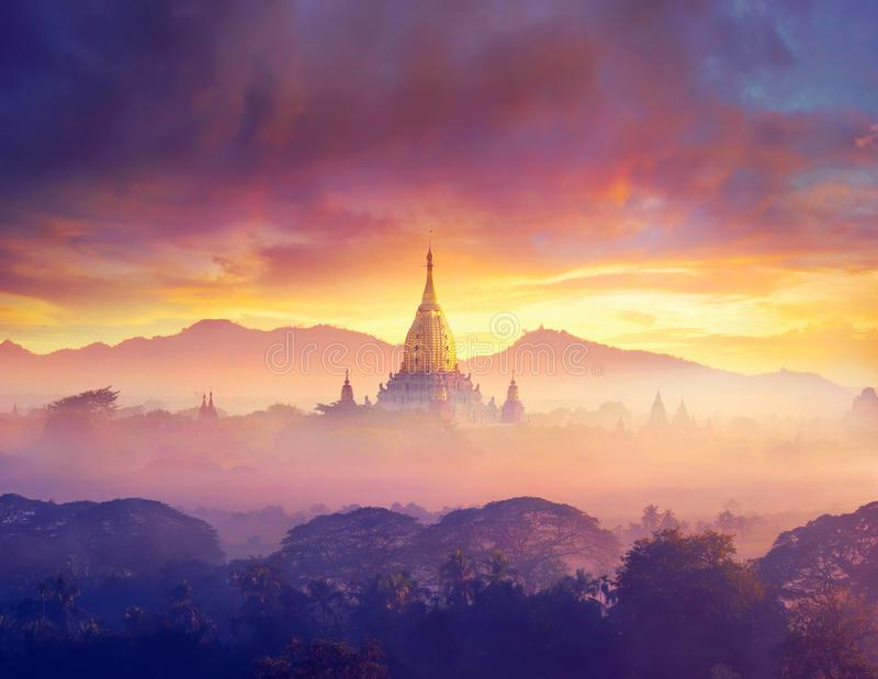 Enjoying colorful sunset over of Buddhist stupas and hot air balloon in the ancient Bagan. Myanmar, Asia stock photography