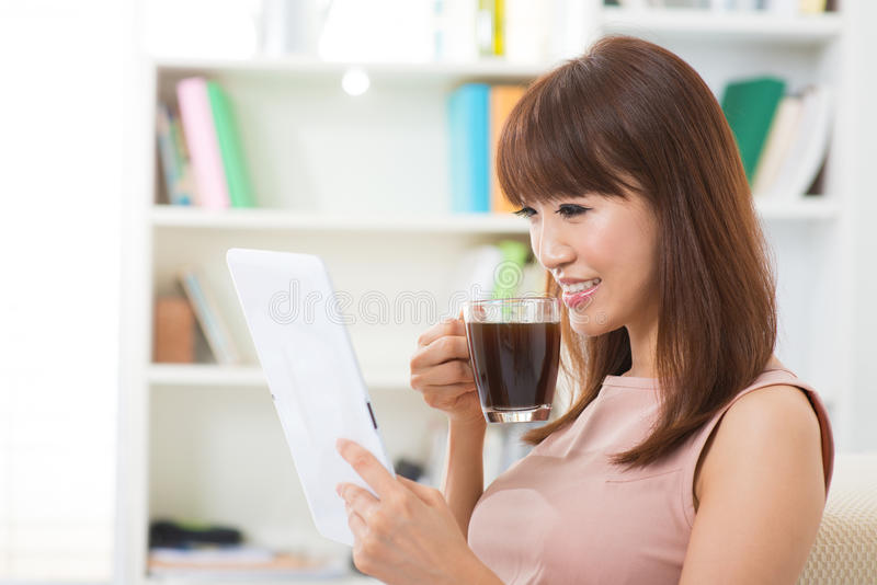 Enjoying Cup Of Coffee And Digital Tablet Royalty Free Stock Images