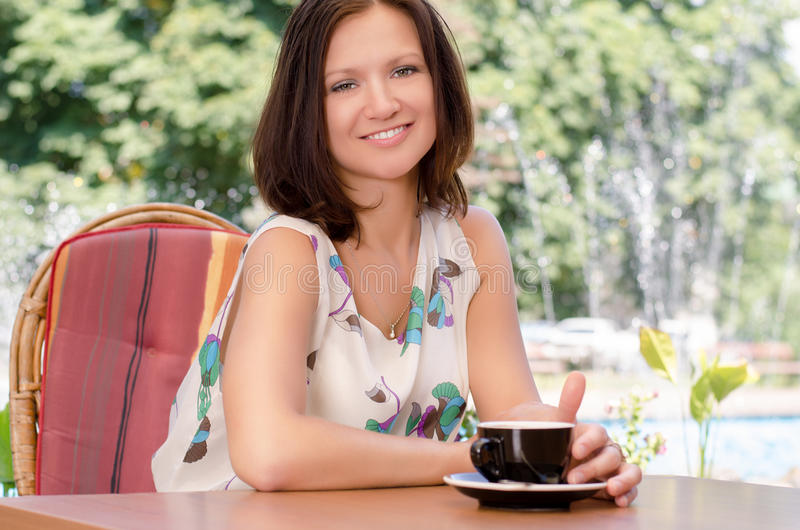 Download Enjoying A Cup Of Coffee Outdoors Stock Image - Image: 25929981