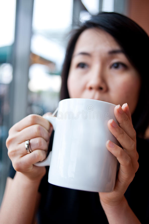 Download Enjoying a cup of tea 4 stock photo. Image of white, wondering - 10718768