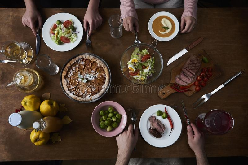 Enjoying dinner with friends. Top view of group of people having stock photo