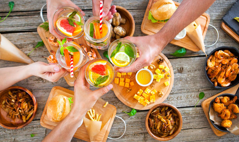 Enjoying dinner with friends. Top view of group of people having royalty free stock photography