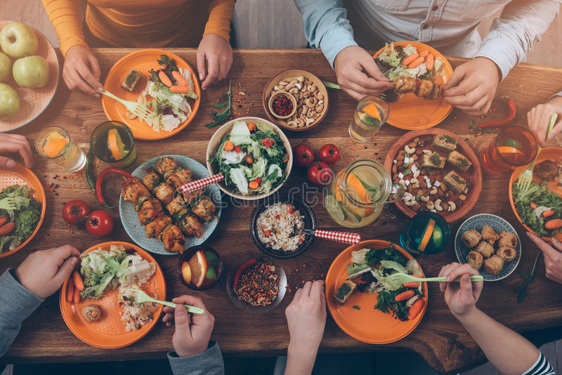 Enjoying dinner with friends. stock photography