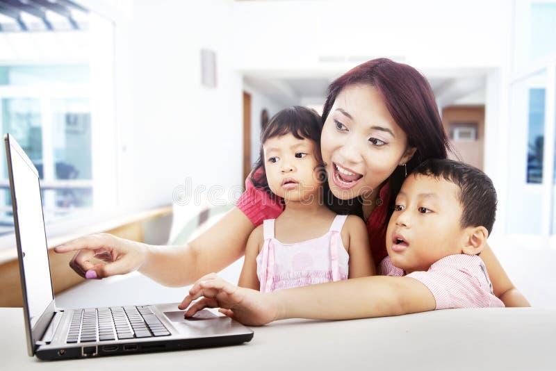 Download Enjoying Entertainment On Laptop At Home Royalty Free Stock Image - Image: 26813316