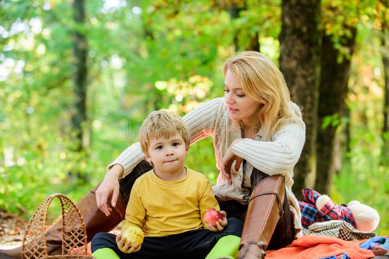 Enjoying every moment. Family picnic. Mothers day. Happy son with mother relax in autumn forest. Sunny weather. Healthy royalty free stock photos
