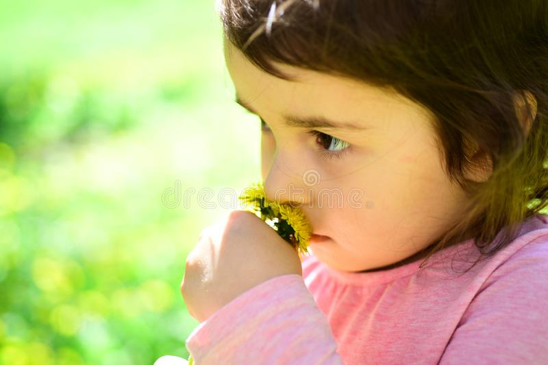 Enjoying every moment. Springtime. weather forecast. Little girl in sunny spring. face skincare. allergy to flowers royalty free stock image