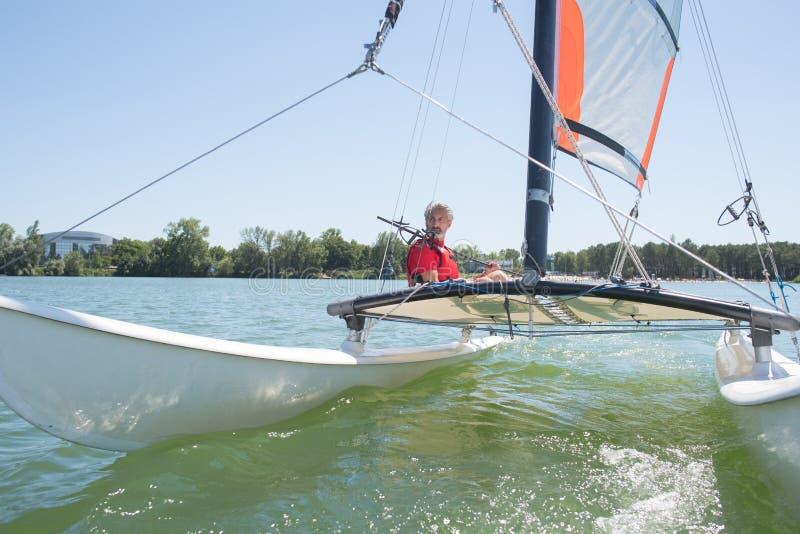 Enjoying extreme sailing with racing sailboat stock photos