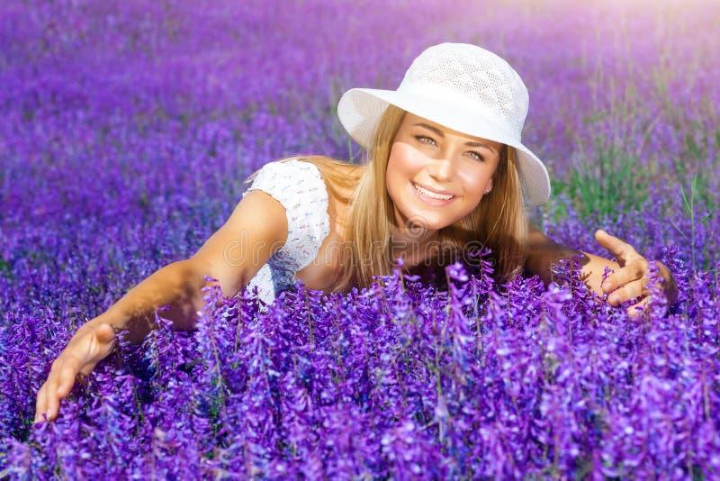 Enjoying flower field stock images