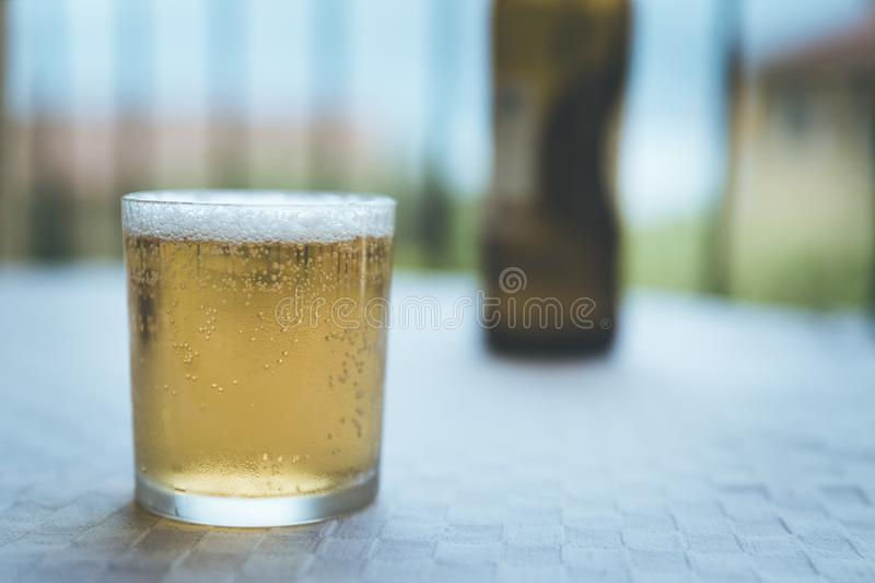 Fresh and cold glass of beer in the holidays, Italy stock images
