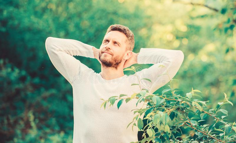 Enjoying green life. man in forest. time to think. ecological life for man. man in green forest. morning in nature royalty free stock photo