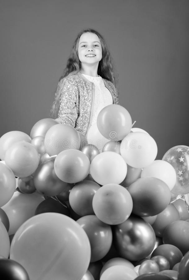Enjoying her special day. Happy little girl having holiday celebration. Small child celebrating birthday holiday. Air. Balloons creating a real holiday for royalty free stock photos