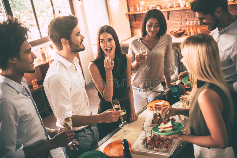 Enjoying home party. stock images