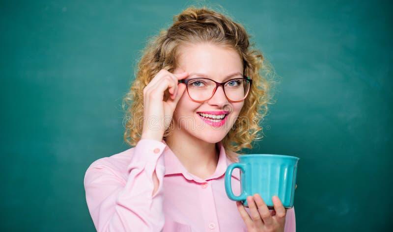 Enjoying hot coffee. school teacher need coffee break. woman with coffee cup at blackboard. good morning. girl. Refreshing with tea drink. idea and inspiration stock image