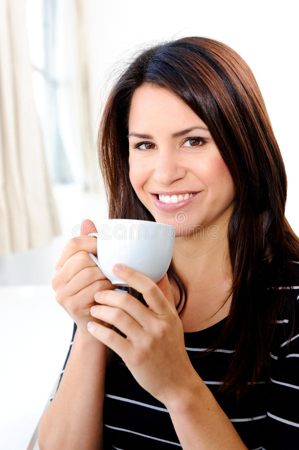 Download Enjoying a hot drink stock photo. Image of positive, casual - 21792750