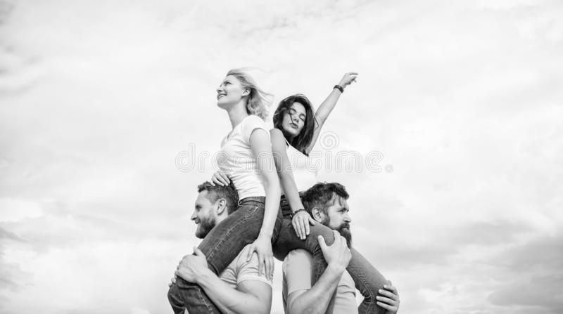 Enjoying life. Playful couples in love smiling on cloudy sky. Loving couples enjoy fun together. Loving couples having stock images