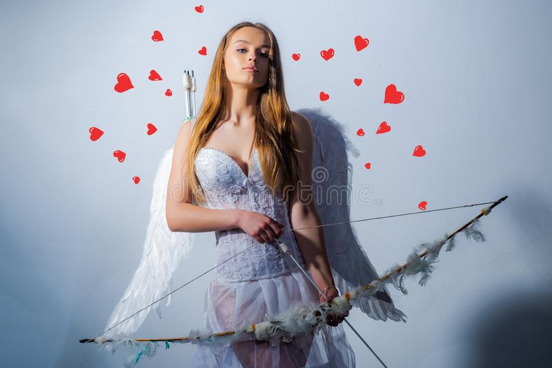 Enjoying magic moment. Arrow of love. Happy Valentines day - copy space. Cupid in valentine day. Charming curly woman in stock photography