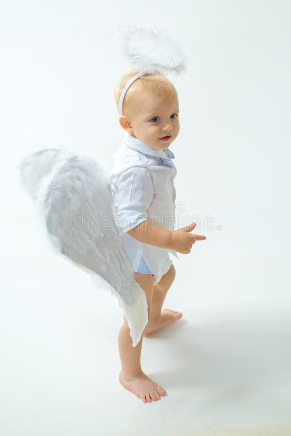 Free Enjoying Magic Moment. Little Boy With Angel Wings And Halo. Baby Angel. Adorable Little Angel Boy. Cute Valentines Stock Photo - 134410440