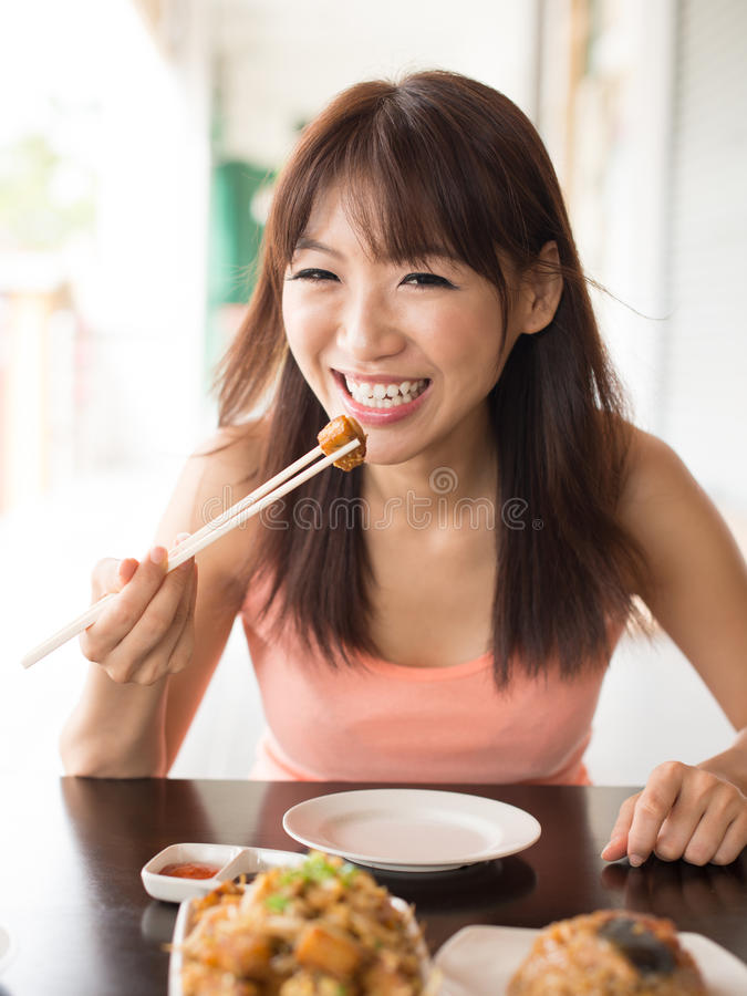 Download Enjoying meal stock photo. Image of female, happy, expression - 27654774