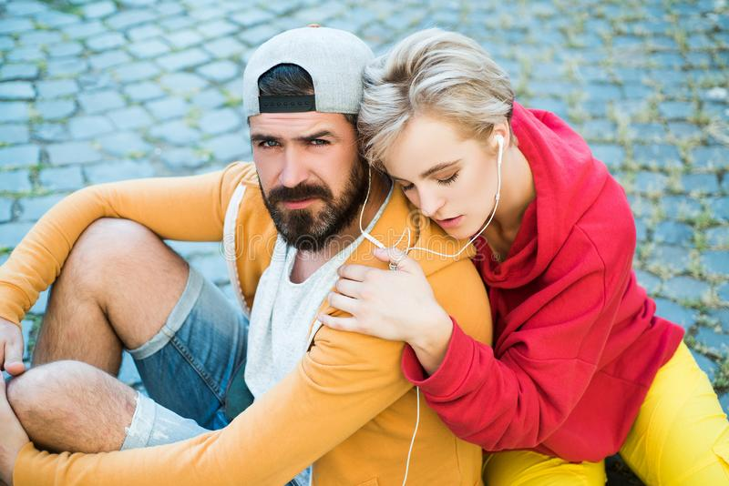 Enjoying music. Freedom feeling. Youth fashion. Feeling free and stylish. Man and woman modern clothes for youth royalty free stock image