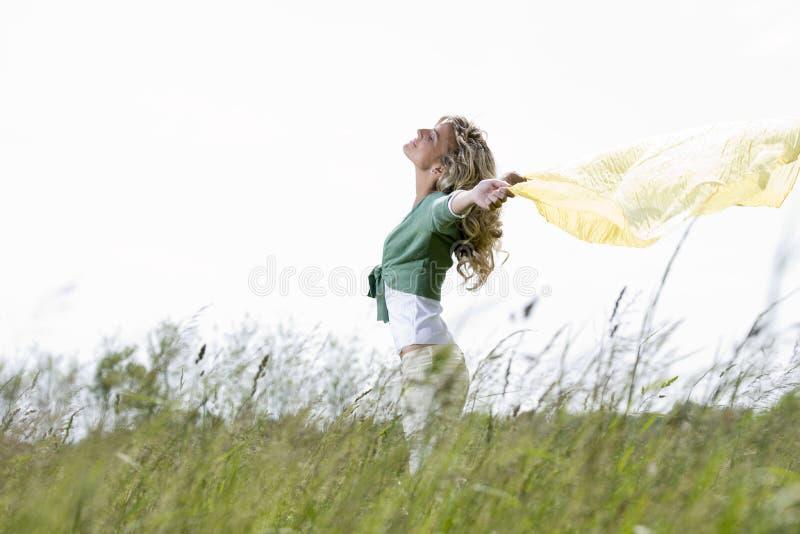 Download Enjoying Nature stock image. Image of drape, field, raised - 26556877