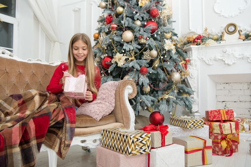 Enjoying New Year party. Child enjoy the holiday. Christmas tree and presents. Happy new year. Winter. xmas online royalty free stock photos