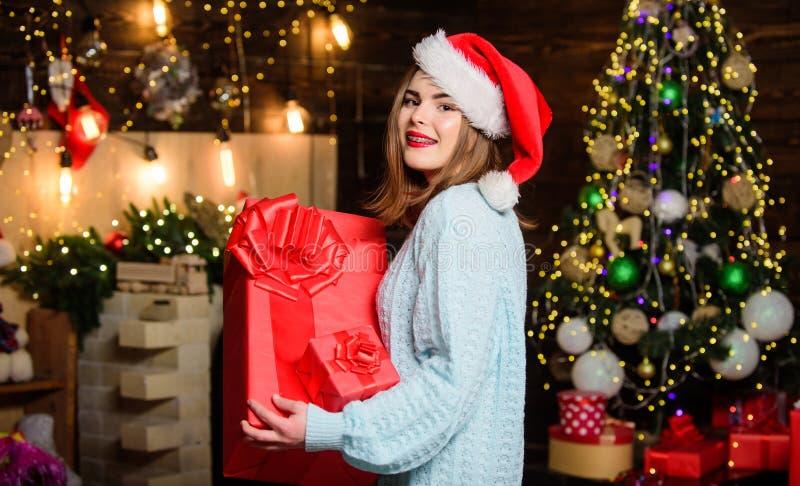 Enjoying New Year party. Christmas tree. Winter holiday. Happy new year. Family celebration. Girl in santa claus hat royalty free stock image