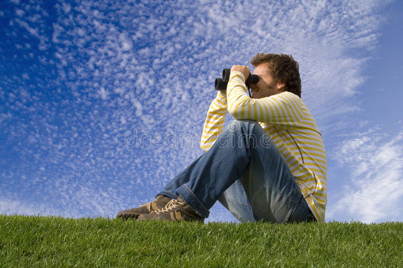 Enjoying and observe the nature. Young man outdoor enjoying and observe the nature royalty free stock photos
