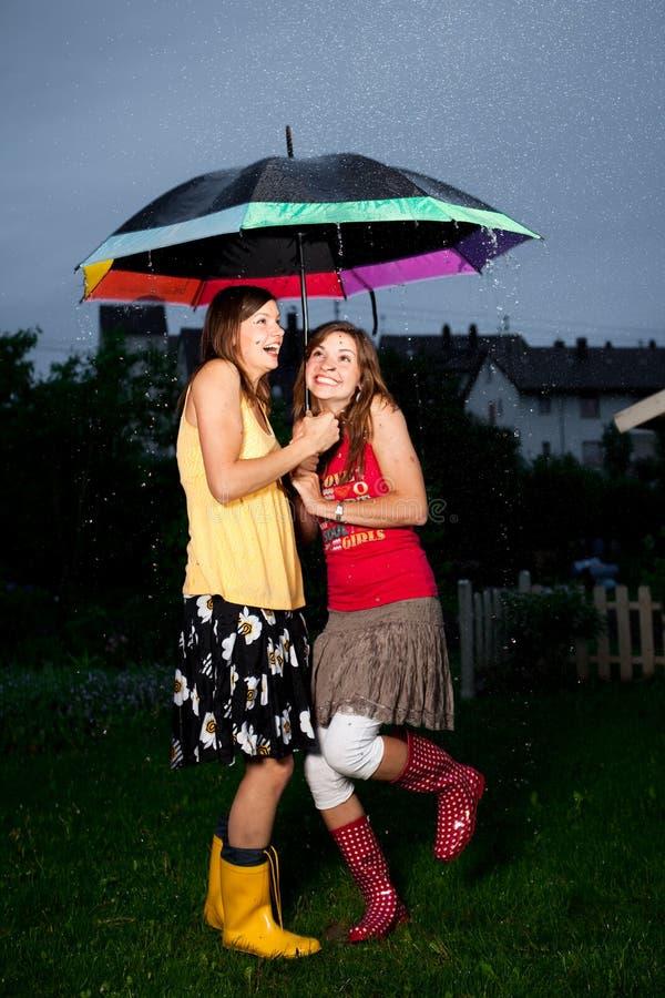 Download Enjoying Rains stock image. Image of cute, standing, teens - 9456679