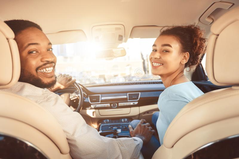 Enjoying road trip together. Young couple driving car royalty free stock photo
