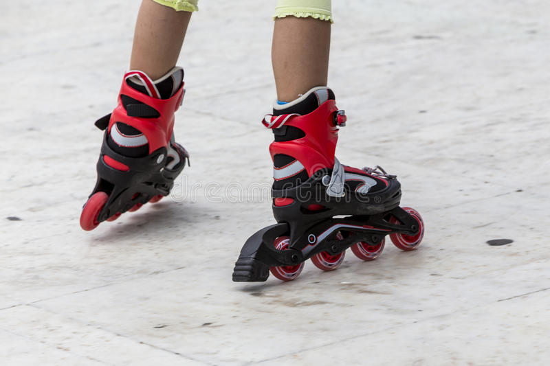 Enjoying roller skating rollerblading on inline skates sport in stock images