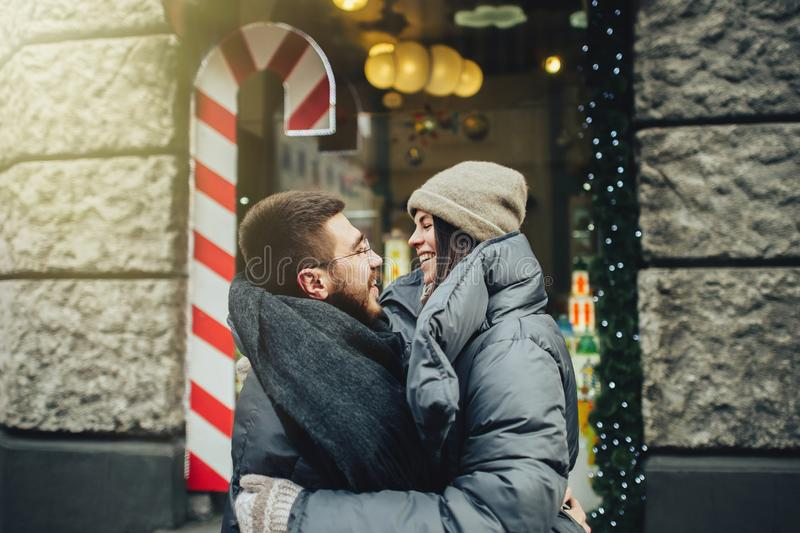 Young romantic couple is having fun outdoors in winter before Ch stock photography