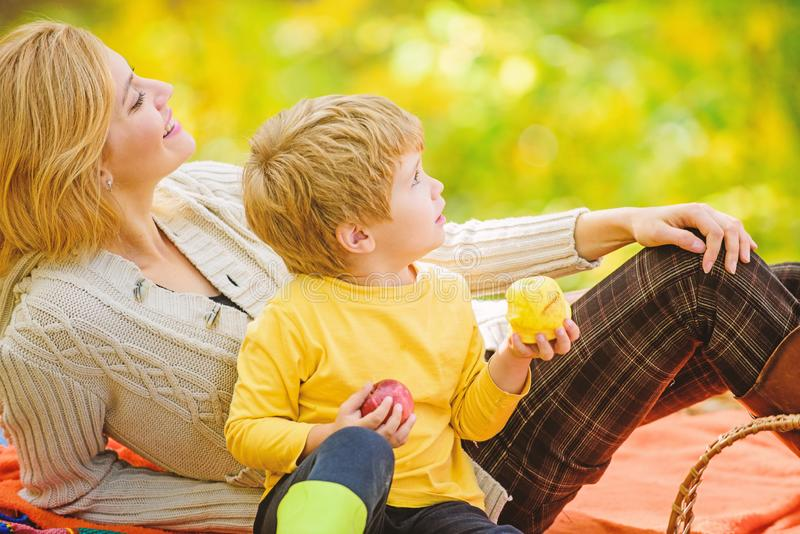 Enjoying spring holiday. Mother love her small boy child. Happy son with mother relax in autumn forest. Sunny weather royalty free stock photos