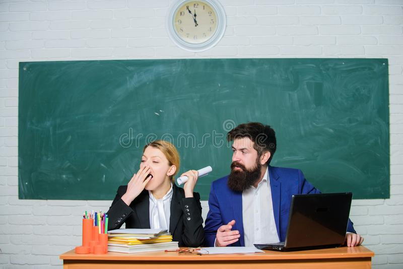 Enjoying student life. businessman and secretary. back to school. formal education. paper work. office life. business. Couple use laptop and documents. teacher stock image