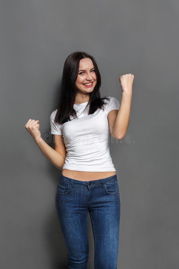 Enjoying success. Happy woman proud of achievement stock images