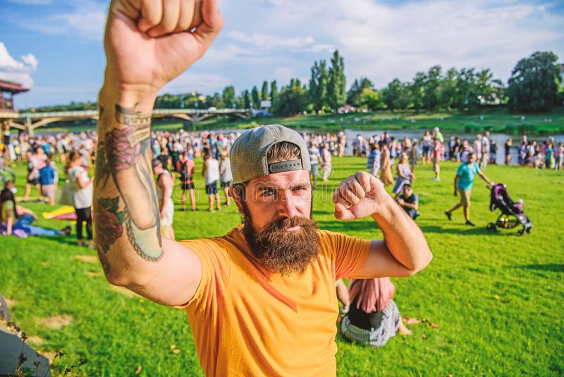 Enjoying success. Hipster celebrating success on summer nature. Bearded man being excited about success. Brutal stock photo