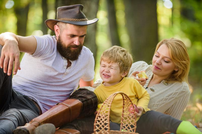 Enjoying summer rest. Spring mood. Happy family day. Sunny weather. Healthy food. Family picnic. Happy son with parents stock photos