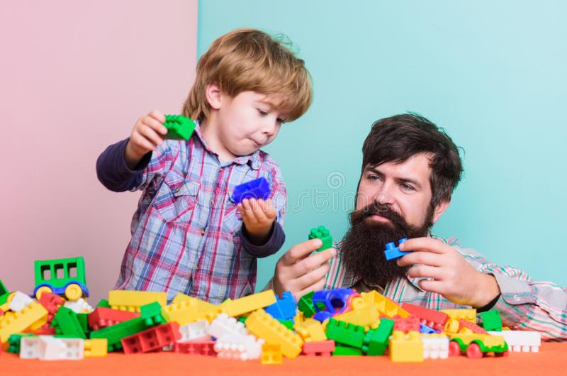 Enjoying time in play club. love. child development. father and son play game. happy family leisure. small boy with dad stock photo