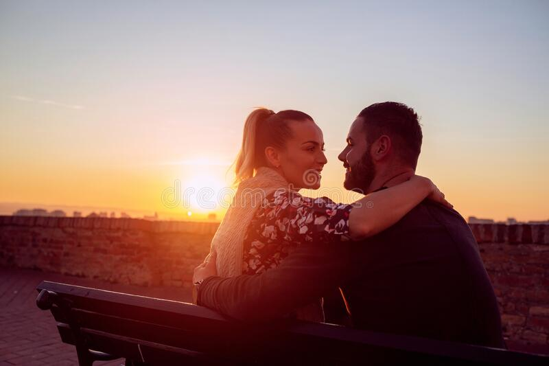 Enjoying time together. man and woman hugging  at evening stock images