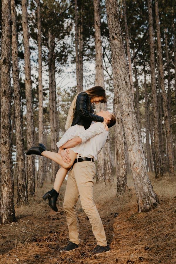 Enjoying time together. Stylish and loving couple enjoying each other outdoors - Image.  stock photography