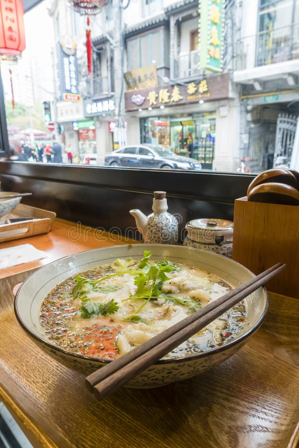 Enjoying traditional Shanghai noodle soup stock images
