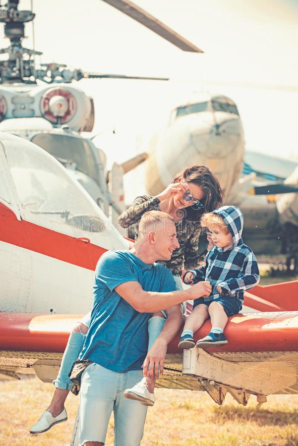 Enjoying travelling by air. Happy family vacation. Family couple with son on vacation travel. Woman and man with boy royalty free stock photography