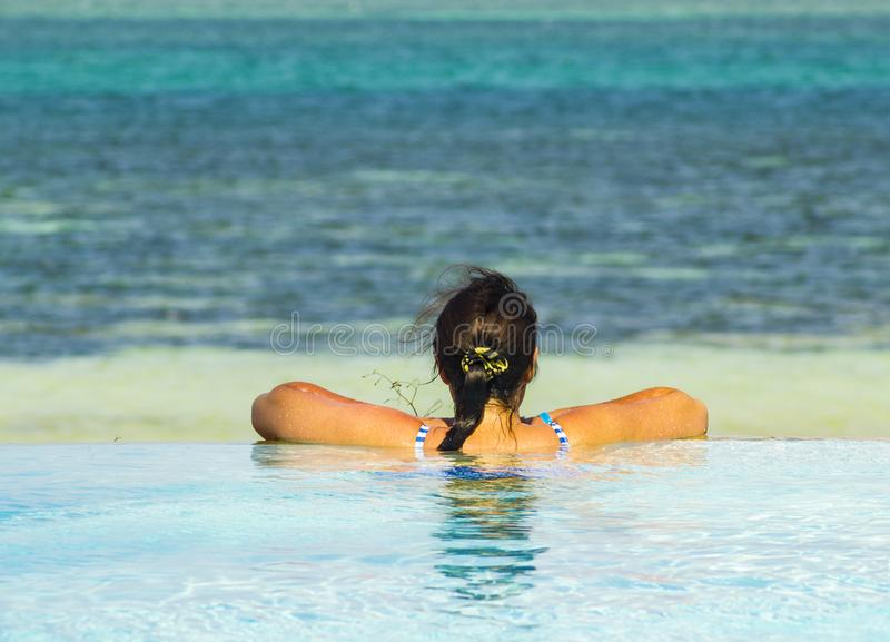 Enjoying the view endless swimming pool looking over the ocean Mombassa Kenya africa stock photo
