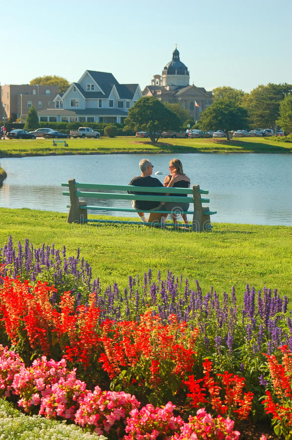 Enjoying a warm summer's day. A Couple enjoying a nice seat and view on a beautiful summer's day royalty free stock image